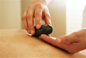 Hot stone massage is an example of the many massages offered at Brighton Wellbeing clinic